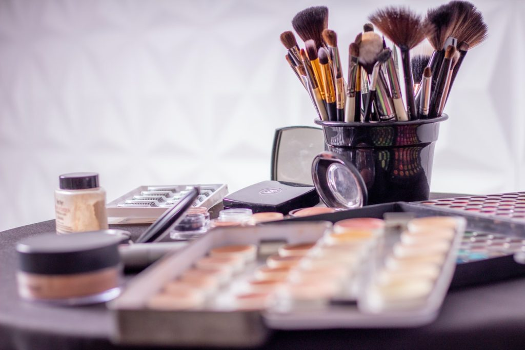 A collection of makeup brushes and powders.